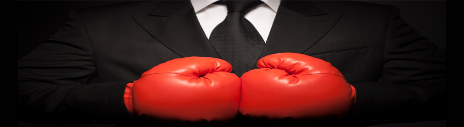 lawyer wearing boxing gloves