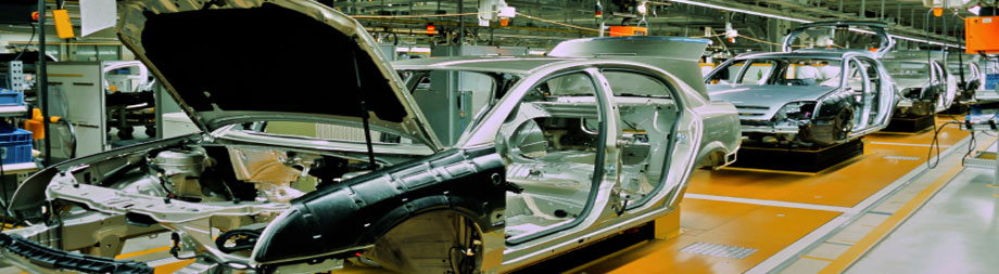 manufacturing cars on an assembly line